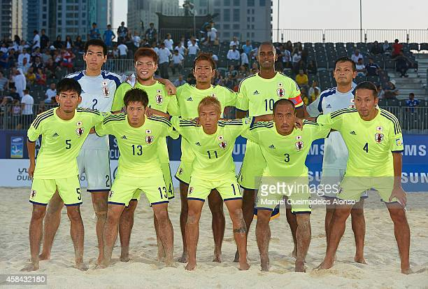 Japan pose for a team photograph before day one of the Beach Soccer Intercontinental Cup 2014 match between Russia and Japan at Dubai International...