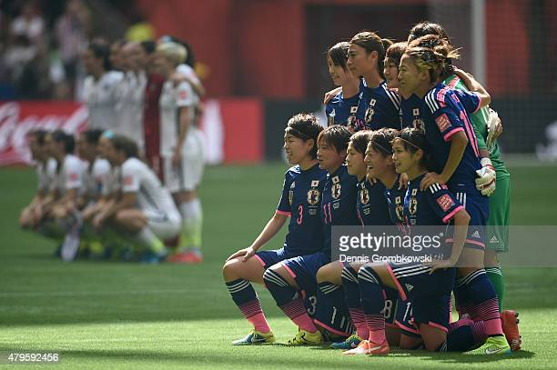 Japan poses for a team photo alongside the United States before the FIFA Women's World Cup Canada 2015 Final at BC Place Stadium on July 5 2015 in...