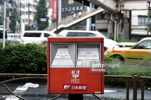 A Japan Post Co mail box stands in Tokyo Japan on Tuesday Sept 8 2015 Japan Post Holdings Co and its banking and insurance units are preparing for...