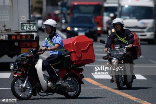 Japan Post Co motorcycles drive along a rode near a post office in Kawasaki Kanagawa Japan on Tuesday April 25 2017 Japan Post Holdings Co Ltdwill...