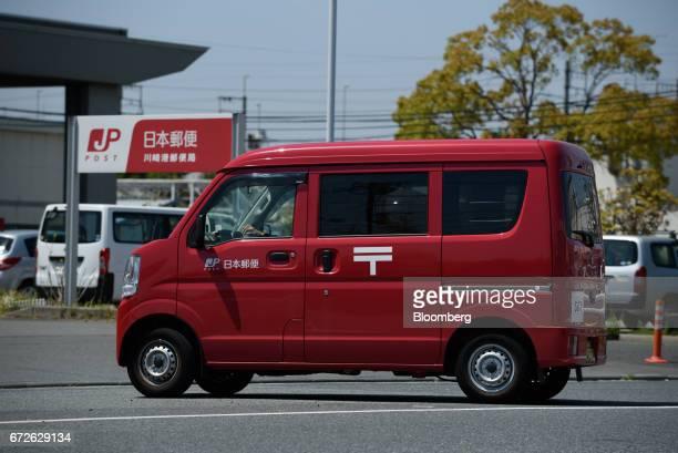 A Japan Post Co truck drives on a road at a post office in Kawasaki Kanagawa Japan on Tuesday April 25 2017 Japan Post Holdings Co Ltdwill book a...