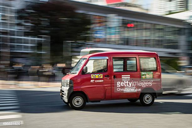 Japan Post delivery van is seen driving along a road in downtown Tokyo on November 4 2015 in Tokyo Japan Shares in Japan Post with its banking and...
