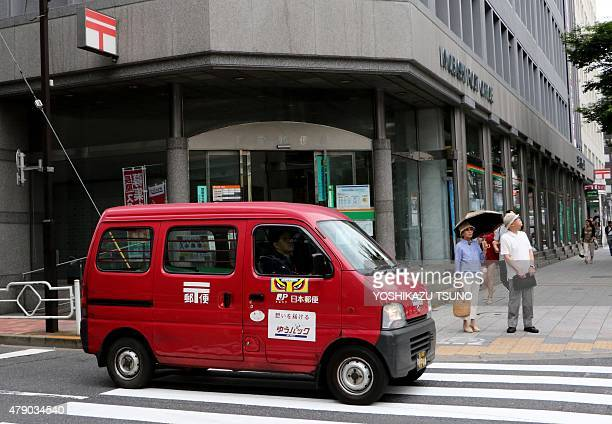 A Japan Post van is seen past its office in Tokyo on June 30 2015 Japan Post Holdings and its two subsidiaries announced to file with the Tokyo Stock...