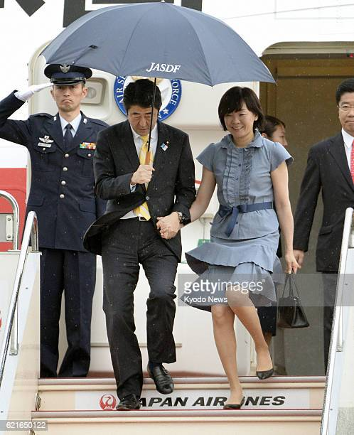 TOKYO Japan Prime Minister Shinzo Abe accompanied by his wife Akie arrives at Tokyo's Haneda airport from Europe on June 20 after attending the G8...