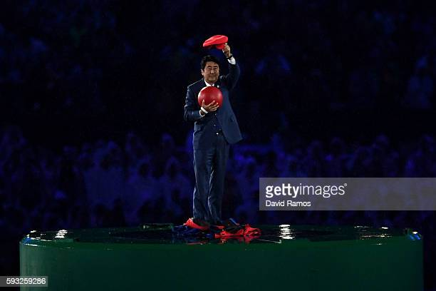 Japan Prime Minister Shinzo Abe appears during the 'Love Sport Tokyo 2020' segment during the Closing Ceremony on Day 16 of the Rio 2016 Olympic...