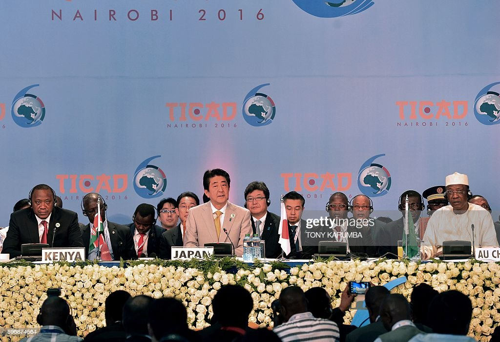 Japan Prime Minister Shinzo Abe gives his closing remarks as Kenya's President Uhuru Kenyatta and President of Chad Idriss Deby look on at the end of...