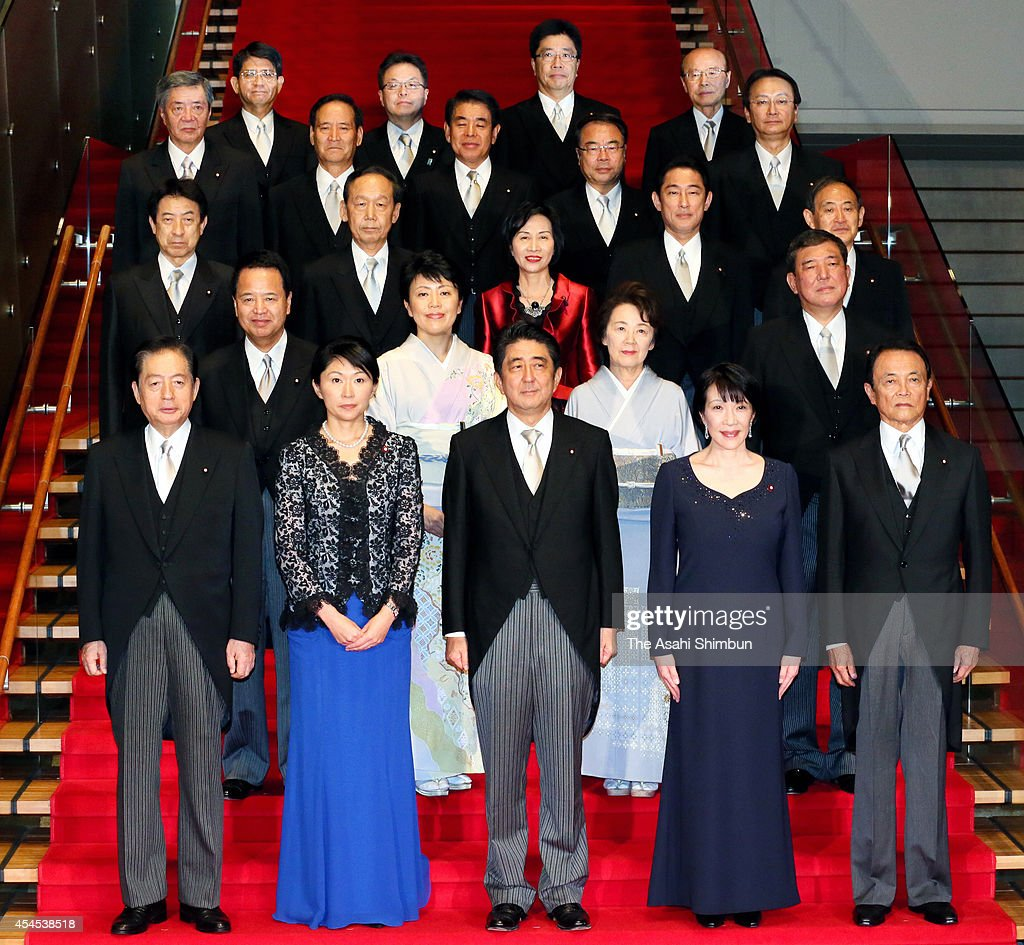 Japan Prime Minister Shinzo Abe poses with his newly appointed cabinet members at the prime minister's official residence on September 3 2014 in...