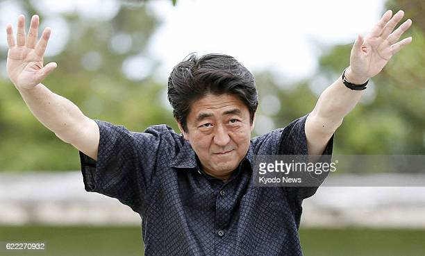 MIYAKO Japan Prime Minister Shinzo Abe who leads the Liberal Democratic Party waves to voters on Miyako Island Okinawa Prefecture on July 17 ahead of...