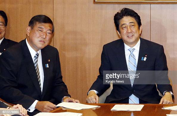TOKYO Japan Prime Minster Shinzo Abe and Shigeru Ishiba secretary general of the ruling Liberal Democratic Party attend a meeting of their party...