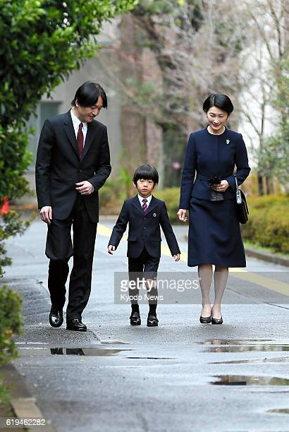 TOKYO Japan Prince Hisahito the third in line to the Chrysanthemum Throne heads for a graduation ceremony at his kindergarten affiliated with...