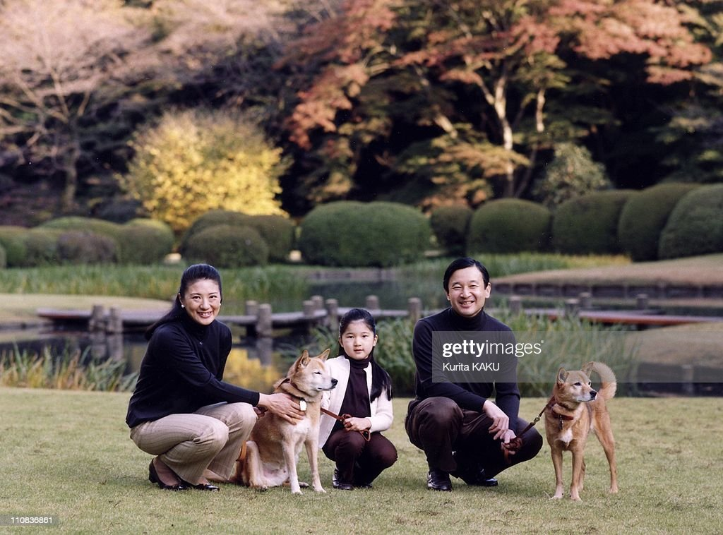 Japan Princess Aiko Celebrates Her 6Th Birthday In Tokyo, Japan On December 01, 2007 - In this photo released by the Imperial Household Agency, Japan's Crown Prince Naruhito, right, his wife, Crown Princess Masako, left, and their daughter, Princess Aiko, smile as they stroll with their dogs at the Akasaka imperial estate where they live Sunday, Nov - 18, 2007 - Aiko celebrates her 6th birthday.