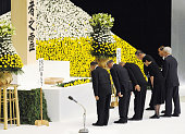 TOKYO Japan Representatives of relatives of the war dead bow after offering flowers during an annual war memorial ceremony at Nippon Budokan hall in...