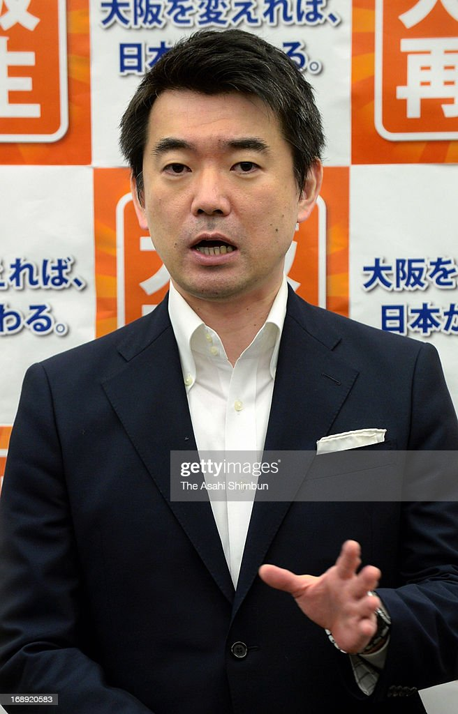 Japan Restoration Party co-head and Osaka Mayor <a gi-track='captionPersonalityLinkClicked' href=/galleries/search?phrase=Toru+Hashimoto&family=editorial&specificpeople=4847016 ng-click='$event.stopPropagation()'>Toru Hashimoto</a> responds to reporters that Hashimoto's recent remark on wartime comfort women may have been 'inappropriate', at Osaka City Hall on May 16, 2013 in Osaka, Japan.