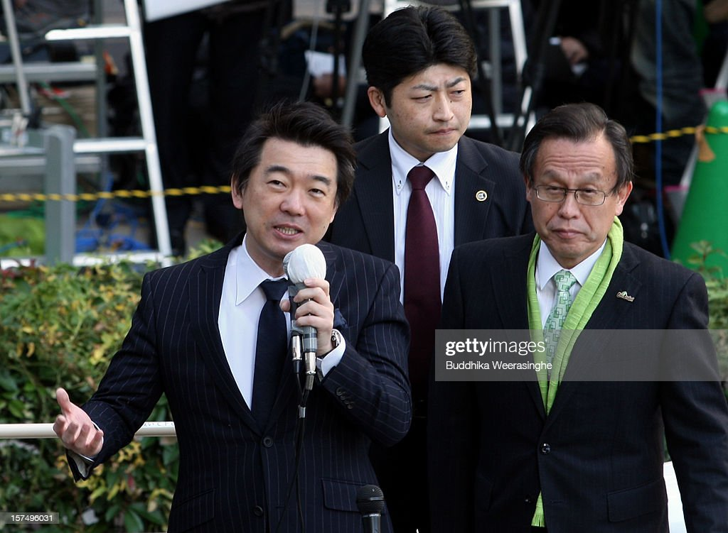 Japan Restoration Party deputy leader Osaka Mayor <a gi-track='captionPersonalityLinkClicked' href=/galleries/search?phrase=Toru+Hashimoto&family=editorial&specificpeople=4847016 ng-click='$event.stopPropagation()'>Toru Hashimoto</a> (L) speaks to voters during his official election party campaign for the upcoming lower house election on December 4, 2012 in Osaka, Japan. Japanese vote in the general election on December 16.