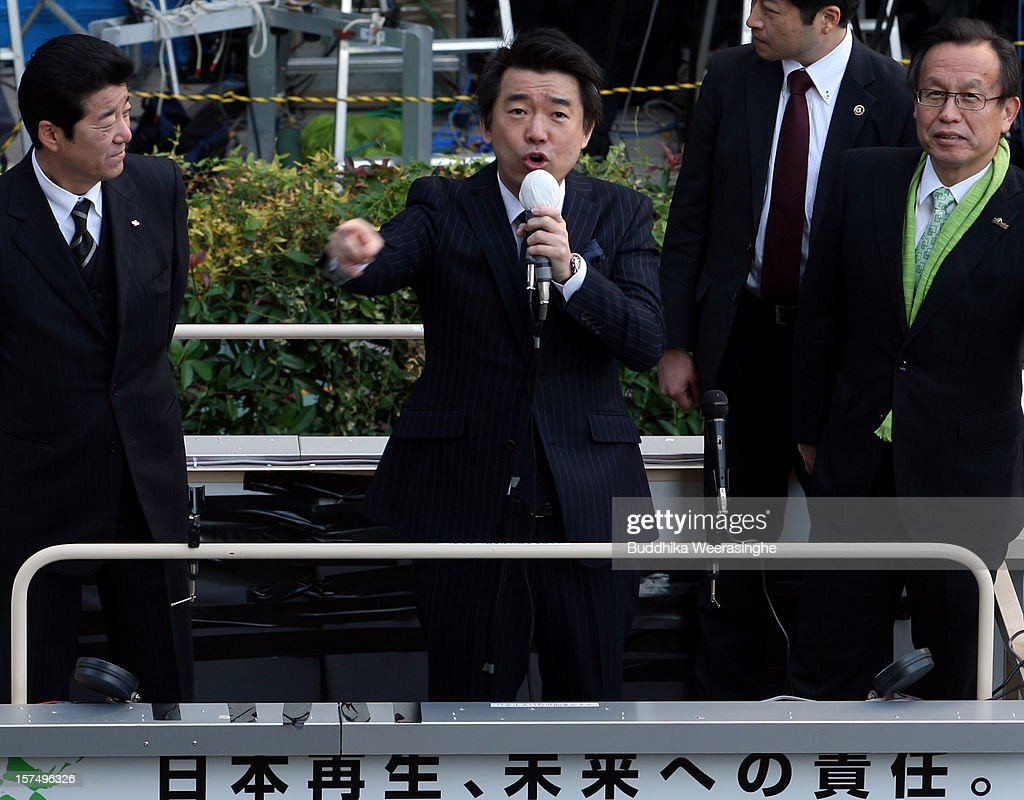 Japan Restoration Party deputy leader Osaka Mayor <a gi-track='captionPersonalityLinkClicked' href=/galleries/search?phrase=Toru+Hashimoto&family=editorial&specificpeople=4847016 ng-click='$event.stopPropagation()'>Toru Hashimoto</a> (C) speaks to voters during his official election party campaign for the upcoming lower house election on December 4, 2012 in Osaka, Japan. Japanese vote in the general election on December 16.