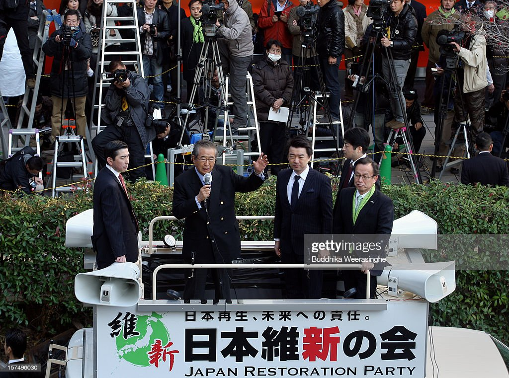 Japan Restoration Party leader former Tokyo Govener <a gi-track='captionPersonalityLinkClicked' href=/galleries/search?phrase=Shintaro+Ishihara&family=editorial&specificpeople=665335 ng-click='$event.stopPropagation()'>Shintaro Ishihara</a> (2nd L) speaks to voters as deputy leader Osaka Mayor <a gi-track='captionPersonalityLinkClicked' href=/galleries/search?phrase=Toru+Hashimoto&family=editorial&specificpeople=4847016 ng-click='$event.stopPropagation()'>Toru Hashimoto</a> (C) looks on during their official election party campaign for the upcoming lower house election on December 4, 2012 in Osaka, Japan. Japanese vote in the general election on December 16.