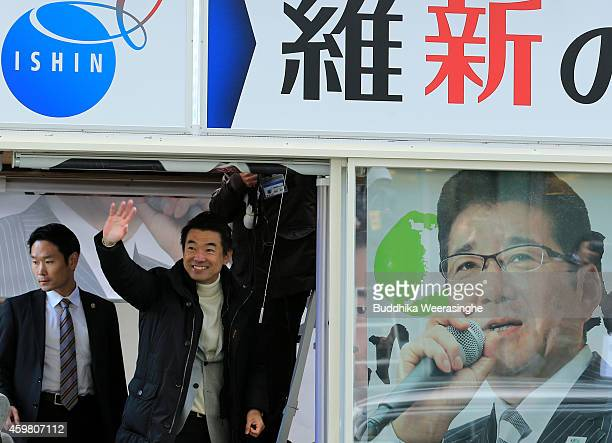 Japan Restoration Party leader Osaka Mayor Toru Hashimoto waves to his suppoters from campaign car during his official election party campaign for...
