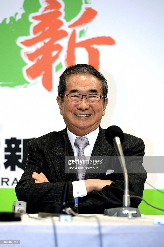 Japan Restoration Party president <a gi-track='captionPersonalityLinkClicked' href=/galleries/search?phrase=Shintaro+Ishihara&family=editorial&specificpeople=665335 ng-click='$event.stopPropagation()'>Shintaro Ishihara</a> smiles at the party election center on December 16, 2012 in Tokyo, Japan. Japan Restoration Party won 54 seats. The Liberal Democratic Party and coalition New Komeito gained 325 seats at the lower house and return to power while ruling Democratic Party of Japan made the historical defeat, dropped to 57 seat.