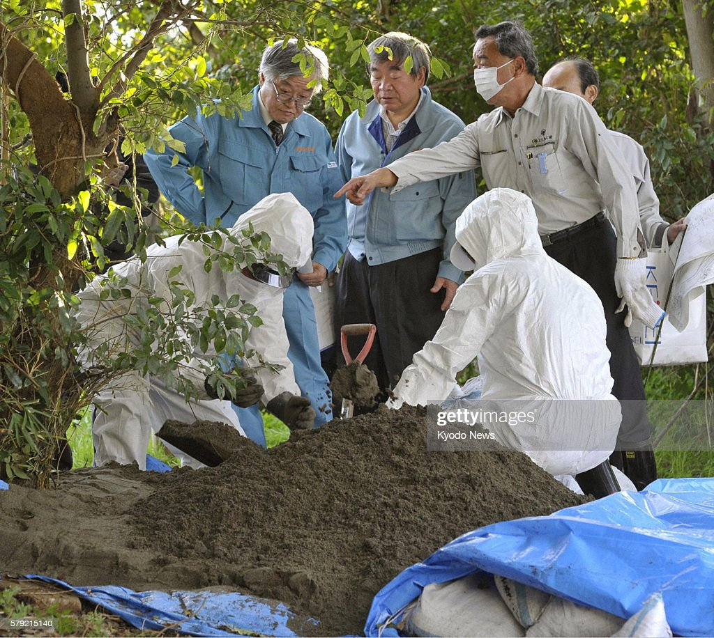 KASHIWA Japan Science ministry officials examine the site where a high level of radioactive cesium has been detected in the soil in Kashiwa Chiba...