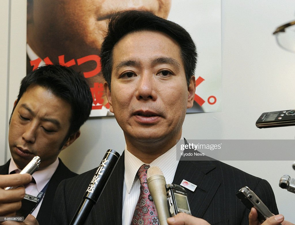 TOKYO Japan Seiji Maehara policy chief of the ruling Democratic Party of Japan speaks with reporters on Nov 9 in Tokyo after the party's project team...