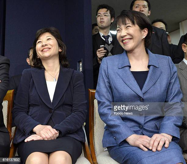 TOKYO Japan Seiko Noda and Sanae Takaichi smile during a press conference in Tokyo on Dec 25 after they were picked as chief of the General Council...