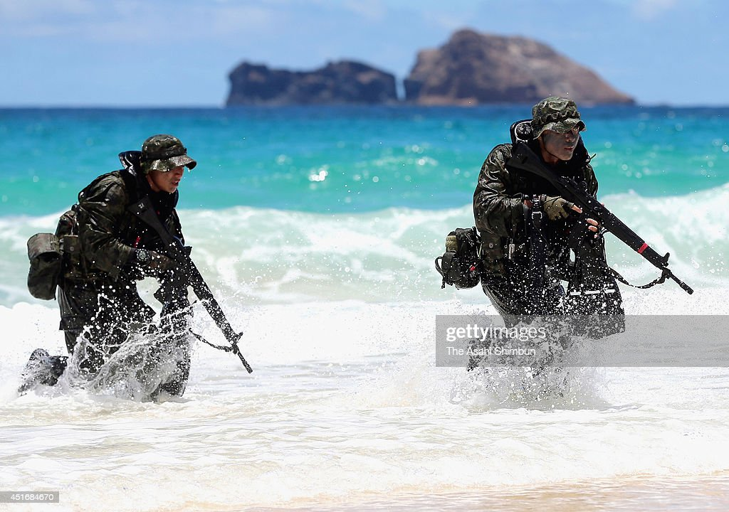 Japan Self-Defense Force members attend a landing operation as a part of the 'Pacific Rim' joint exercise on July 1, 2014 in Kaneohe, Hawaii. Prime Minister Abe's administration approved a document that revises the government's interpretation of war-renouncing Article 9 of the Constitution to allow Japan to exercise the right to collective self-defense.