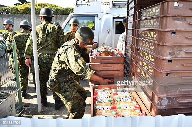 Japan SelfDefense Forces carry relief supplies a day after the 2016 Kumamoto Earthquake at the Mashiki Town Hall on April 15 2016 in Mashiki Kumamoto...