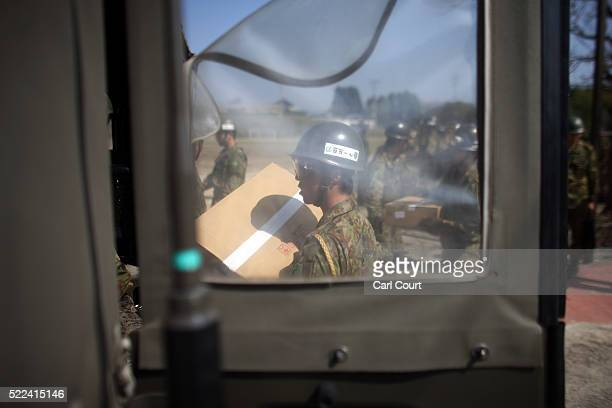 Japan SelfDefense Forces prepare relief supplies delivered by a US Marine Corp Osprey following an earthquake on April 19 2016 in Minamiaso near...