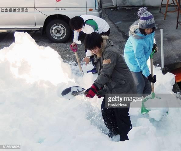 KOFU Japan Senior high school students shovel snow in Kofu Yamanashi Prefecture on Feb 19 2014 With a record snowfall having blanketed the prefecture...