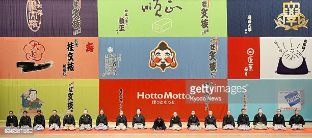 OSAKA Japan Seventeen leading ''rakugo'' storytellers from across Japan gather on stage to offer wellwishing speeches for Katsura Bunshi seen in the...