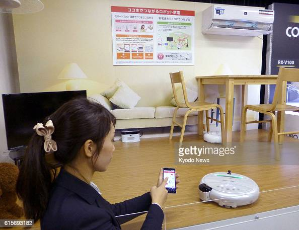 OSAKA Japan Sharp Corp demonstrates a new service using its Cocorobo robot vacuum cleaner in Osaka on Nov 21 2012 The electric appliance maker said...