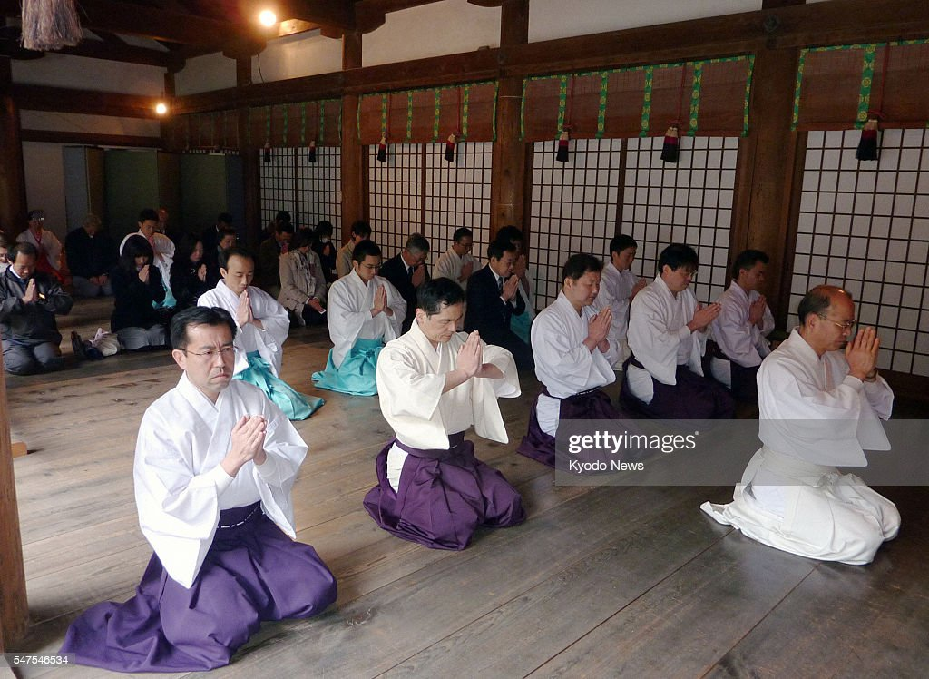 NARA Japan Shinto priests and visitors offer prayers for the safety of those affected in the massive March 11 earthquake and tsunami and the...
