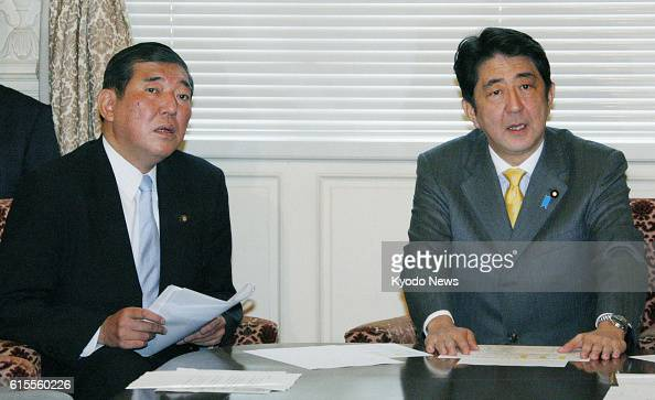 TOKYO Japan Shinzo Abe president of the main opposition Liberal Democratic Party and LDP Secretary General Shigeru Ishiba attend a meeting of party...