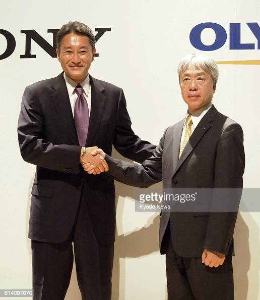 TOKYO Japan Sony Corp Kazuo Hirai and Olympus Corp President Hiroyuki Sasa shake hands in a press conference in Tokyo on Oct 1 on their new tieup...