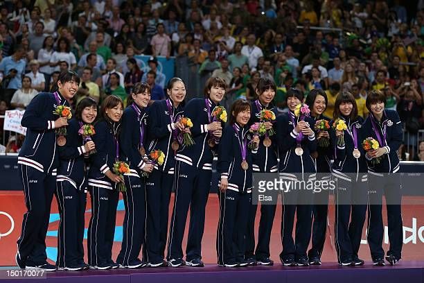 Japan stands on the podium with their bronze medals after the Women's Volleyball gold medal match on Day 15 of the London 2012 Olympic Games at Earls...
