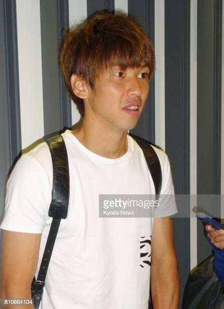 Japan striker Yuya Osako speaks to reporters at Narita airport near Tokyo on July 8 before going back to Europe Osako said he is determined to score...