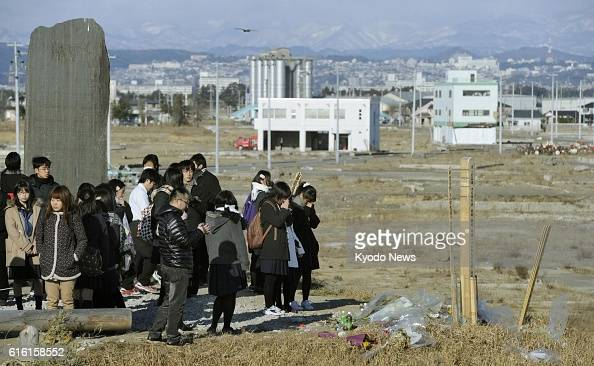 NATORI Japan Students of Shuyukan Senior High School in Fukuoka southwestern Japan take a look at a site devastated by the March 11 tsunami from...