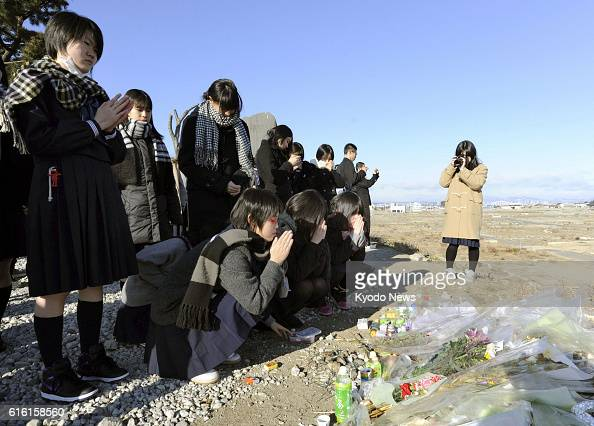 NATORI Japan Students of Shuyukan Senior High School in Fukuoka southwestern Japan offer prayers in the Yuriage district in Natori which was...
