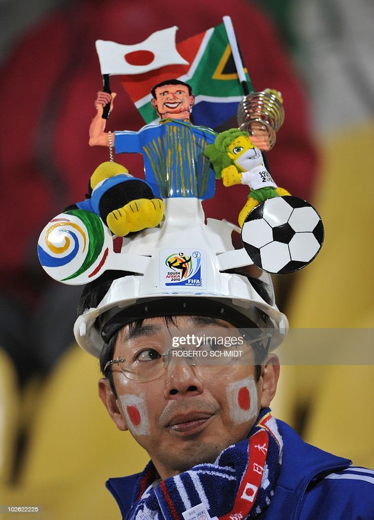 A Japan supporter wearing a Makarapa cheers prior to the start of the Group E first round 2010 World Cup football match Denmark vs Japan on June 24...