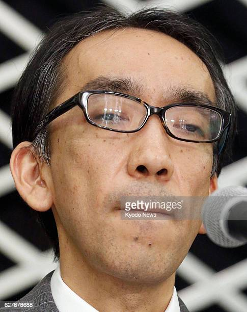 TOKYO Japan Takashi Niigaki a music lecturer bites his lips during a press conference at a Tokyo hotel on Feb 6 the day after confessing that he has...