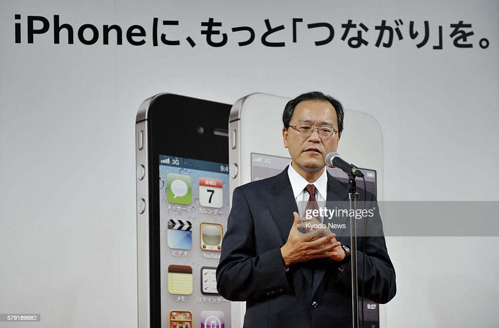 TOKYO Japan Takashi Tanaka president of KDDI Corp attends a ceremony marking the launch of the iPhone 4S at one of the company's outlets in Tokyo's...