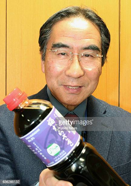 FUKUI Japan Takashi Utagawa a specially appointed professor at Fukui Prefectural University holds a bottle of alcoholfree soy sauce called...