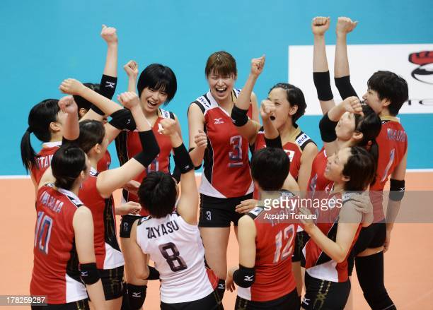 Japan team cereblate after winning the match against Italy during day one of the FIVB World Grand Prix Sapporo 2013 match between Japan and Italy at...