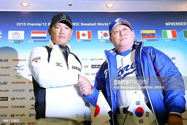 Japan team coach Hiroki Kokubo and Korea team coach Kim InSik pose for a photograph during the Samurai Japan press conference and training session at...