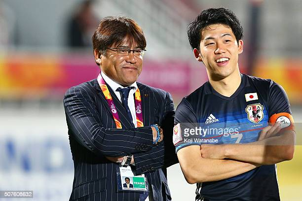 Japan team coach Makoto Teguramori and Endo Wataru of Japan celebrate winning after the AFC U23 Championship final match between South Korea and...