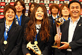 Japan team coach Norio Sasaki Homare Sawa and Yukari Kinga attend a press conference as the Women's World Cup winning team return home at The Capitol...