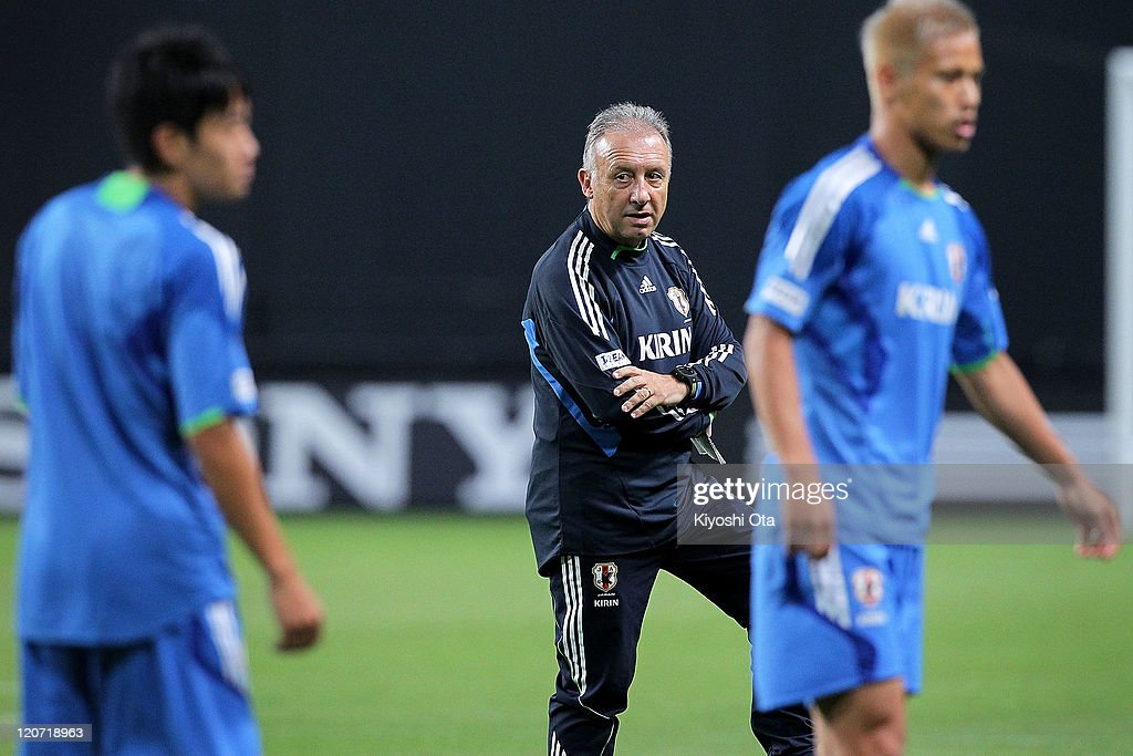 Japan team head coach Alberto Zaccheroni (C) looks on during the Japan national team training session ahead of the Kirin Challenge Cup international friendly match against South Korea at Sapporo Dome on August 9, 2011 in Sapporo, Japan.