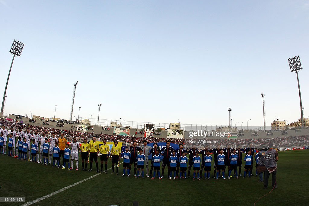 Japan team line up before the FIFA World Cup Asian qualifier match between Jordan and Japan at King Abdullah International Stadium on March 26, 2013 in Amman, Jordan.