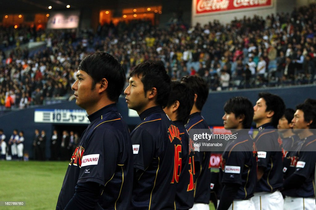Japan team line up for national anthem during the friendly game between Hanshin Tigers and Japan at Kyocera Dome Osaka on February 26, 2013 in Osaka, Japan.