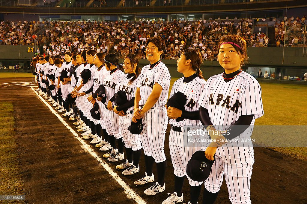 Japan team line up for national anthem during the IBAF Women's Baseball World Cup Group A game between Japan and Australia at Sun Marine Stadium on September 1, 2014 in Miyazaki, Japan.